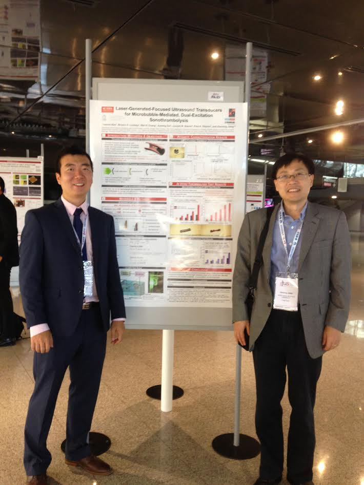 Jinwook and Dr. Jiang in front of their poster